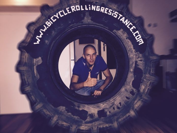 Jarno Bierman in a giant tire giving a thumbs up