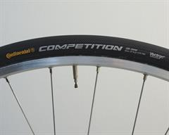 Continental Competition (tubular) road bike tire on a rolling resistance test machine
