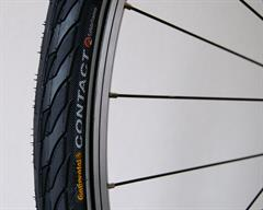 Continental Contact II Touring/E-Bike on a rolling resistance test machine