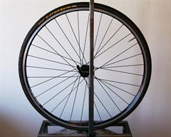 Continental Gatorskin road bike tire on a rolling resistance test machine