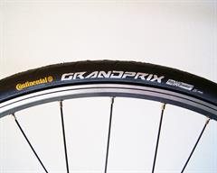 Continental Grand Prix road bike tire on a rolling resistance test machine
