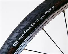 Continental Grand Prix 4 Season road bike tire on a rolling resistance test machine
