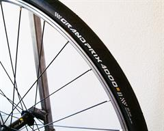 Continental Grand Prix 4000S II road bike tire on a rolling resistance test machine