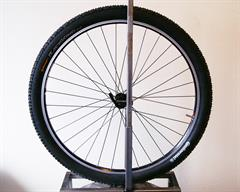 Continental Race King Performance  mountain bike tire on a rolling resistance test machine