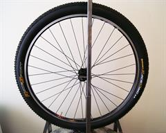 Continental Race King RaceSport mountain bike tire on a rolling resistance test machine