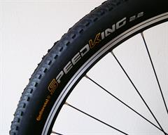Continental Speed King II RaceSport  mountain bike tire on a rolling resistance test machine