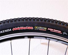 Kenda Small Block Eight mountain bike tire on a rolling resistance test machine