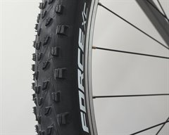 Michelin Force XC  mountain bike tire on a rolling resistance test machine