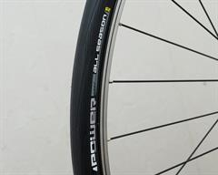 Michelin Power All Season road bike tire on a rolling resistance test machine