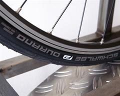 Schwalbe Durano road bike tire on a rolling resistance test machine