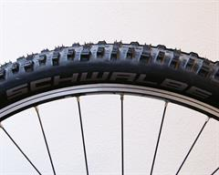 Schwalbe Nobby Nic SnakeSkin  mountain bike tire on a rolling resistance test machine