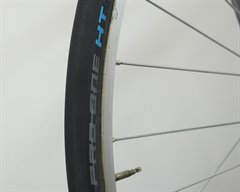 Schwalbe Pro One HT (tubular) road bike tire on a rolling resistance test machine