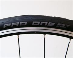 Schwalbe Pro One Tubeless road bike tire on a rolling resistance test machine