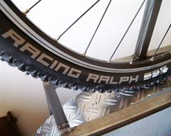 Schwalbe Racing Ralph SnakeSkin mountain bike tire on a rolling resistance test machine
