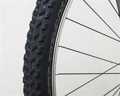 Specialized S-Works Fast Trak  mountain bike tire on a rolling resistance test machine