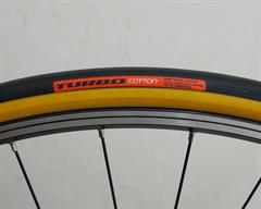 Specialized Turbo Cotton road bike tire on a rolling resistance test machine