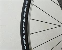Veloflex Corsa road bike tire on a rolling resistance test machine