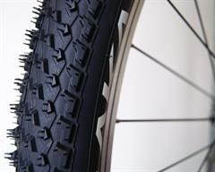 Vittoria AKA  mountain bike tire on a rolling resistance test machine