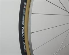 Vittoria Corsa G+ (tubular) road bike tire on a rolling resistance test machine