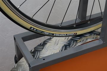 picture of a Vittoria Corsa (Open) G+ Graphene on a rolling resistance test machine