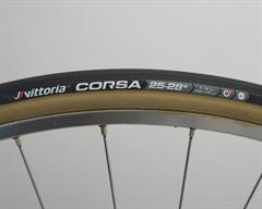 Vittoria Corsa Speed (tubular) road bike tire on a rolling resistance test machine