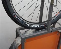 Vittoria Mezcal TNT G+ mountain bike tire on a rolling resistance test machine