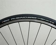 Vittoria Rubino Pro G+ road bike tire on a rolling resistance test machine