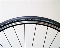 Vredestein Fortezza Senso All Weather road bike tire on a rolling resistance test machine